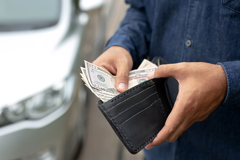 How much does enclosed auto transport cost?